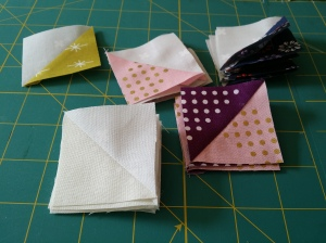 "Lovely little (2 1/8"") HSTs sewn from Cotton and Steel fabrics."